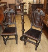 A pair late Victorian Flemish oak dining chairs and a torchere