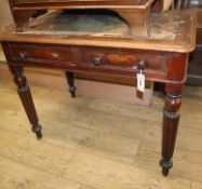 A Victorian mahogany two drawer writing table W.90cm