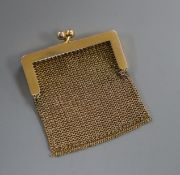 A small 14k yellow metal mesh purse.
