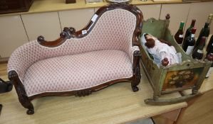 A miniature chaise longue with doll and painted crib