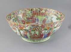 A large Chinese Canton-decorated famille rose punch bowl, c.1830, the interior and exterior