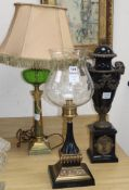 A Victorian style 'oil lamp', a candlestick with storm shade and a faux marble and gilt metal urn (