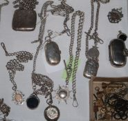 A group of silver watch chains, vestas, sovereign holders, fobs and keys etc