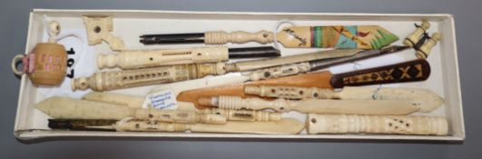 A collection of ivory Stanhope dip pens/paper knives, an ivory tape measure and bodkin case, a