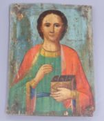 A late 19th century Russian painted wood icon 23 x 17cm