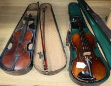A German Strad style violin and a small violin and two bows