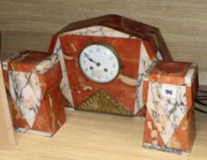A French Art Deco rouge marble clock garniture