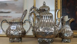 A four piece plated tea set and two silver brushes