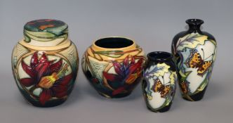 Three Moorcroft Butterfly pattern vases and a jar and cover tallest 16cm (4)