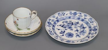 A Meissen bird painted cup and two saucers and an onion plate, 19th century