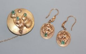 A Victorian yellow metal and emerald set foliate brooch and a pair of similar drop earrings,