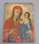 A 19th century Russian painted wood icon 28 x 21cm