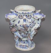 An early 19th century faience 'putto and cornucopia' vase