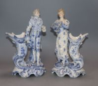 A pair of Continental porcelain figural spill vases