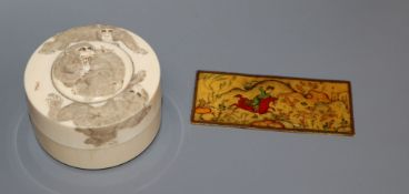 A Japanese ivory box and a Persian painted bone panel
