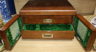A Victorian oak cutlery box
