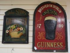 A Guinness sign and a John Stims Greengrocer sign