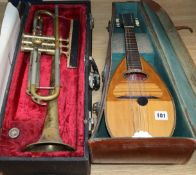 A mandolin and a cased Besson trumpet