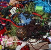 A large quantity of Chinese costume jewellery and other items.