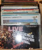 A collection of Lps and 45s including Credence Clearwater Revival, Jonny Cash, Elton John etc.