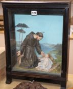 An early 20th century Italian religious diorama depicting Saint Francis and the infant Jesus