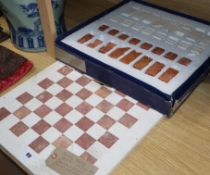 A marble chess board with pieces