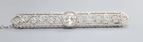 A modern 1920's style pierced 750 white metal and diamond set bar brooch, the collet set central