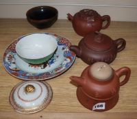 Three Yixing teapots and a hare's fur bowl and another bowl, export plate and a lid.