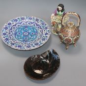 A Continental porcelain figure of a flower seller, a Satsuma teapot and cover and two dishes