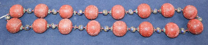 A Chinese cinnabar lacquer 'shou' bead necklace, early 20th century length 37cm