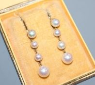 A pair of 1950's Swedish 18k and graduated cultured pearl drop earrings, drop 34mm.