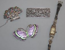 A George V silver and three colour enamel butterfly brooch, a 935 cocktail watch and two marcasite