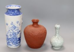 A Chinese crackleglaze vase, blue and white vase and a redware vase tallest 27cm
