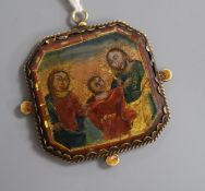 An 18th/19th century Continental double sided reverse painted icon pendant width 5.5cm