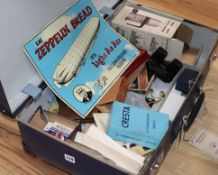 A vintage globetrotter case containing assorted ephemera to include glamour photo booklets, enamel