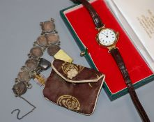 A gentleman's early 20th century 15ct gold manual wind wrist watch and a coin bracelet.