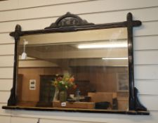 A late Victorian aesthetic movement ebonised overmantel mirror W.112cm