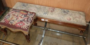 A Victorian mahogany footstool and a fender stool, both with tapestry tops
