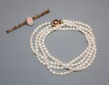 A 15ct and opal bar brooch and a two-row uniform pearl necklace with 14k ball clasp.