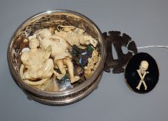 A collection of Japanese ivory carvings, memento mori, a plated caster, a tsuba etc