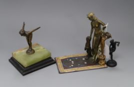 A Bergmann style cold painted bronze group, an Art Deco bronze figure bathing belle and two bronze