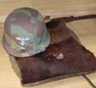 A WWII German ruck-sack helmet, close combat clasp