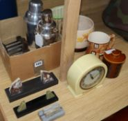 A plated Art Deco cocktail shaker, photo frames and knife rests etc