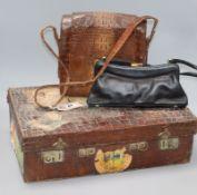 A small crocodile case and two handbags