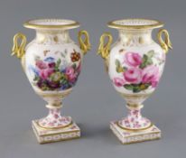 A pair of French porcelain vases, c.1820, the ovoid bodies applied with a pair of gilt swan neck