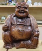 A large carved hardwood Buddha height 54cm