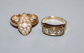 A yellow metal and seed pearl set marquise shaped ring and a 333 yellow metal ring.