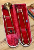 A cased Boosey and Hawkes slide trombone