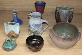 A collection of art pottery, some signed