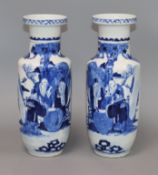 A pair of late 19th century Chinese blue and white vases, bearing Kangxi mark height 29.5cm
